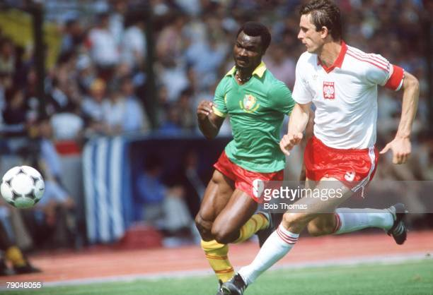 World Cup Finals La Coruna Spain 19th June Poland 0 v Cameroon 0 Cameroon's Roger Milla and Poland's Wladyslaw Zmuda race for the ball
