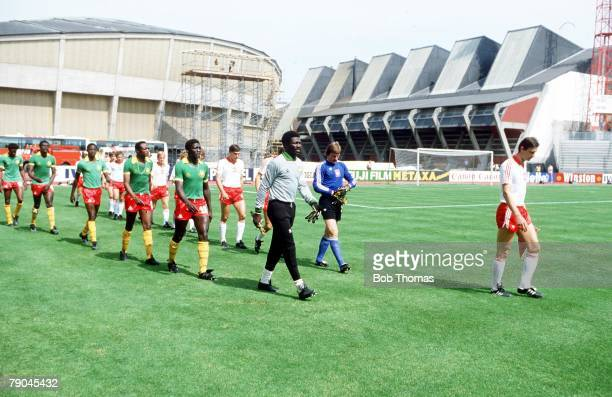 World Cup Finals La Coruna Spain 19th June Poland 0 v Cameroon 0 The two teams are led out by Cameroon's Thomas Nkono and Poland's Wladyslaw Zmuda...