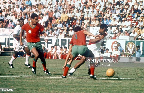 World Cup Finals Leon Mexico 6th June Peru 3 v Morocco 0 Peruvian forward Teofilo Cubillas is challenged by Moroccan defender Khanoussi during the...