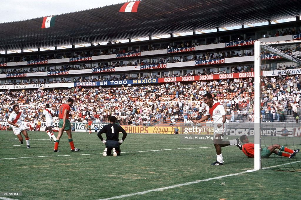 1970 World Cup Finals Leon, Mexico. 6th June, 1970. Peru 3 v Morocco 0. Peruvian striker Teofilo Cubillas turns away to celebrate after scoring one of his two goals past Moroccan goalkeeper Allal Kassou during their Group Four match. : News Photo