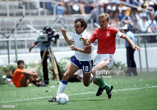 World Cup Finals Leon Mexico 9th June France 3 v Hungary 0 France's Michel Platini in a race for the ball with Hungary's Imre Garaba