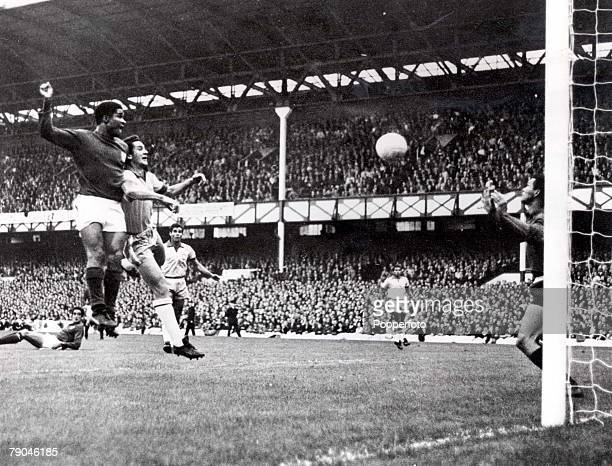 World Cup Finals Liverpool England 19th July Portugal 3 v Brazil 1 Eusebio of Portugal beats Brazil's Orlando to the ball to head home his side's...