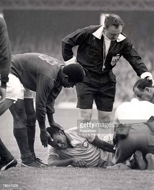 World Cup Finals Liverpool England 19th July Portugal 3 v Brazil 1 Portugal's Eusebio holds the head of Brazilian star Pele seen in agony on the...