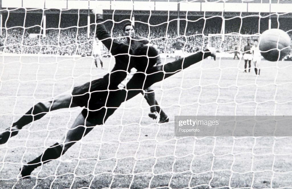 World Cup Finals, 1966. Liverpool, England. 23rd July, 1966. Portugal 5 v North Korea 3. Portugal's Eusebio scores one of his two penalties past the dive of North Korean goalkeeper Li Chang Myung during their match. : News Photo
