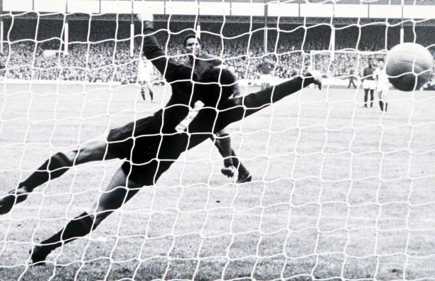 World Cup Finals Liverpool, England, 23rd July Portugal 5 v North Korea 3, Portugal's Eusebio scores one of his two penalties past the dive of North...