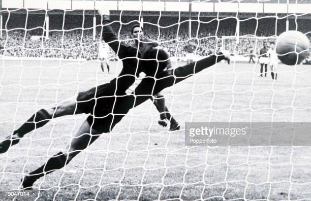 World Cup Finals Liverpool England 23rd July Portugal 5 v North Korea 3 Portugal's Eusebio scores one of his two penalties past the dive of North...