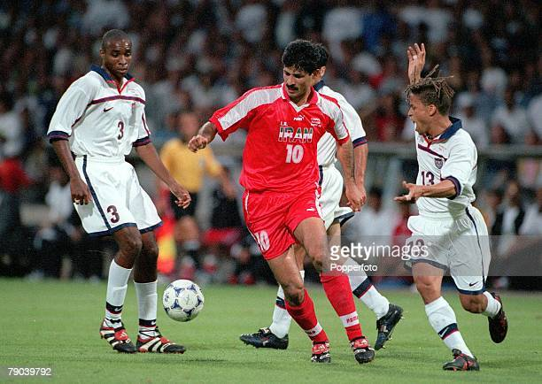 World Cup Finals Lyon France 21st JUNE 1998 USA 1 v Iran 2 Iran's Ali Daei moves past Cobi Jones Eddie Pope USA
