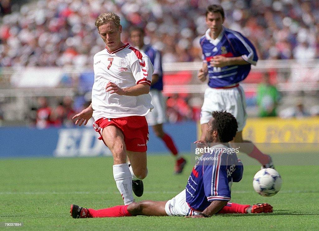 1998 World Cup Finals. Lyon, France. 24th June, 1998 France 2 v Denmark 1. France's Christian Karembeu with Denmark's Allan Nielsen. : Photo d'actualité