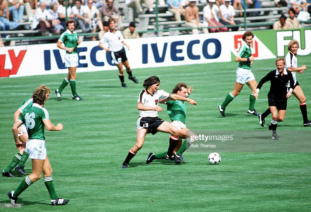 1982 World Cup Finals. Madrid, Spain. 1st July, 1982. Austria 2 v Northern Ireland 2. Northern Ireland's David McCreery is tackled by Austria's Anton Pichler. : News Photo