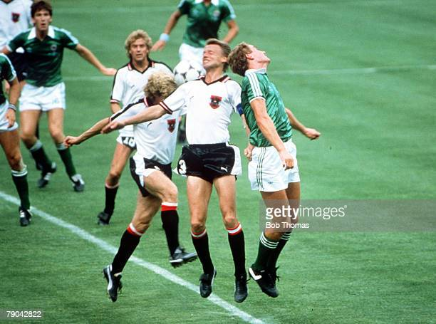 World Cup Finals Madrid Spain 1st July Austria 2 v Northern Ireland 2 Northern Ireland's Billy Hamilton jumps for the ball with Austria's Ernst...