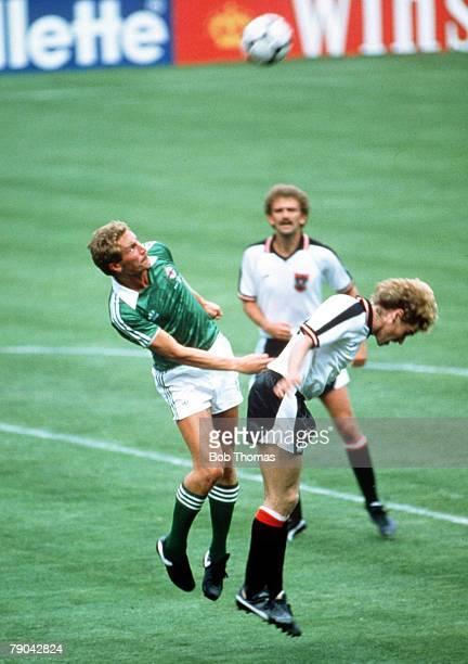 World Cup Finals Madrid Spain 1st July Austria 2 v Northern Ireland 2 Northern Ireland's Billy Hamilton outjumps Austria's Ernst Baumeister to win...