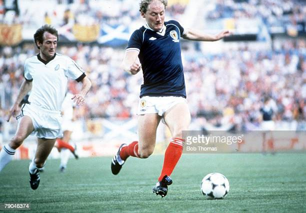 World Cup Finals Malaga Spain 15th June Scotland 5 v New Zealand 2 Scotland's Alan Brazil is chased by New Zealand's John Hill
