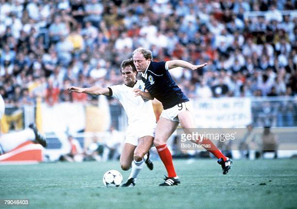 World Cup Finals Malaga Spain 15th June Scotland 5 v New Zealand 2 Scotland's Alan Brazil is challenged by New Zealand's Alan Boath