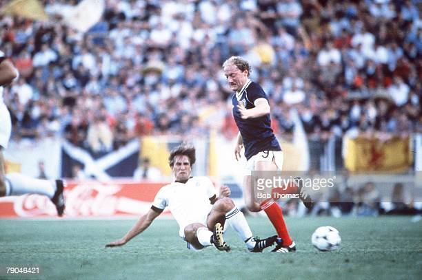 World Cup Finals Malaga Spain 15th June Scotland 5 v New Zealand 2 Scotland's Alan Brazil is tackled by New Zealand's Alan Boath