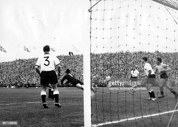 World Cup Finals Malmo Sweden 8th June Germany 3 v Argentina 1 West German goalkeeper Herkenrath dives to punch clear an Argentine attack during...