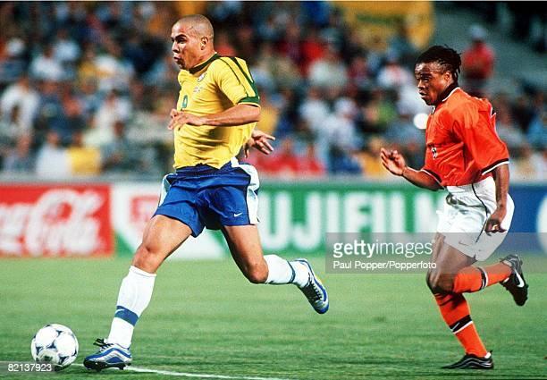 World Cup Finals Marseille France SemiFinal 7th July Brazil 1 v Holland 1 Brazil's Ronaldo races away from Holland's Edgar Davids