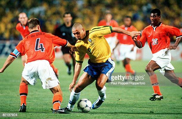 World Cup Finals Marseille France SemiFinal 7th July Brazil 1 v Holland 1 Brazil's Ronaldo takes on Holland's Frank De Boer and Aron Winter