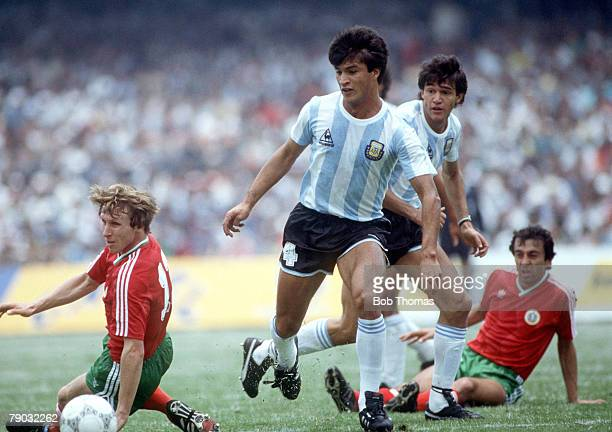 World Cup Finals Mexico City Mexico 10th June Argentina 2 v Bulgaria 0 Argentina's Claudio Borghi is challenged for the ball by Bulgaria's Alexander...
