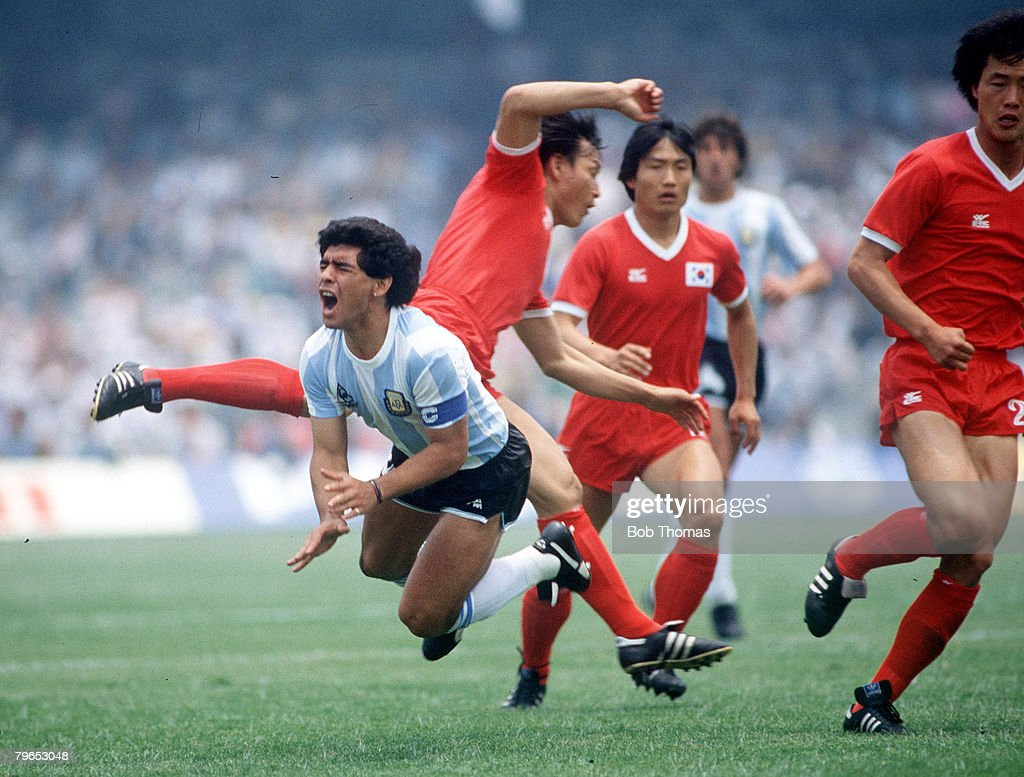 1986 World Cup Finals, Mexico City, Mexico, 2nd June, 1986, Argentina 3 v South Korea 1, Argentina's Diego Maradona grimaces in pain after being fouled by Jung Moo Huh : News Photo