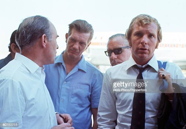 World Cup finals Mexico England captain Bobby Moore is surrounded by newsmen as he arrives at Mexico airport following his release from police...