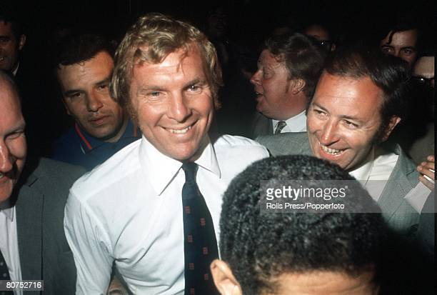 World Cup finals Mexico England captain Bobby Moore simles surrounded by newsmen as he arrives at Mexico airport following his release from police...