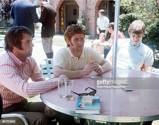 World Cup Finals Mexico England players Geoff Hurst Alan Ball and Emlyn Hughes play cards as they relax in their hotel grounds during the tournament