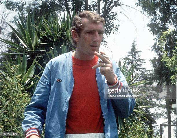 World Cup Finals Mexico England reserve goalkeeper Alex Stepney smokes a cigarette as he relaxes in the grounds of the England team hotel during the...