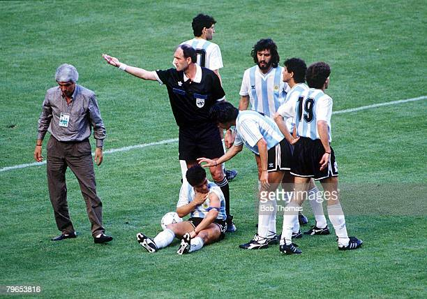 World Cup Finals Milan Italy 8th June Argentina 0 v Cameroon 1 Argentina's Diego Maradona is surrounded by teammates after being fouled watched by...