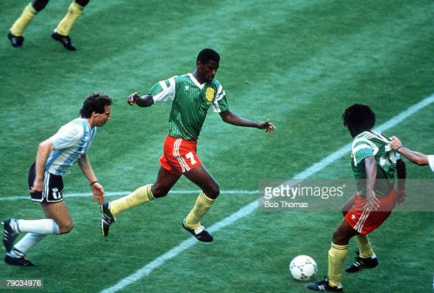 World Cup Finals Milan Italy 8th June Argentina 0 v Cameroon 1 Cameroon's Cyrille Makanaky has his shirt pulled by an Argentine defender as Omam...