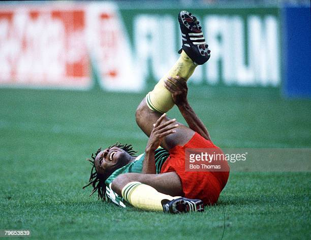 World Cup Finals Milan Italy 8th June Argentina 0 v Cameroon 1 Cameroon's Cyrille Makanaky lies in pain on the ground after being injured