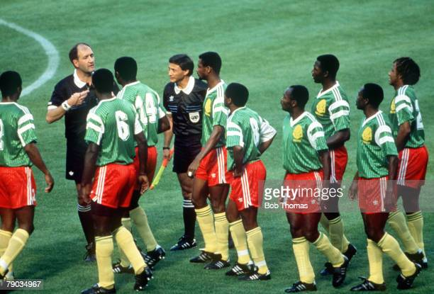 World Cup Finals Milan Italy 8th June Argentina 0 v Cameroon 1 Referee Michel Vautrot is surrounded by almost the whole of the Cameroon team as they...