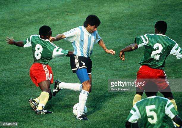 World Cup Finals Milan Italy 8th June Argentina 0 v Cameroon 1 Argentina's Jorge Burruchaga takes on Cameroon's Mbouh Mbouh and Omam Biyick