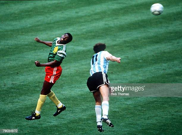 World Cup Finals Milan Italy 8th June Argentina 0 v Cameroon 1 Cameroon's Kana Biyick jumps up for the ball with Argentina's Nestor Fabbri