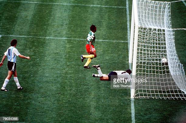 World Cup Finals Milan Italy 8th June Argentina 0 v Cameroon 1 Argentina's goalkeeper Nery Pumpido lies on the ground after being beaten by Omam...