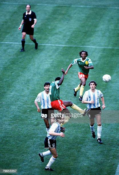World Cup Finals Milan Italy 8th June Argentina 0 v Cameroon 1 Cameroon's Oman Biyick climbs high above Argentine defenders to score the winning goal