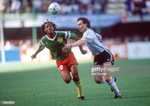 World Cup Finals Milan Italy 8th June Argentina 0 v Cameroon 1 Argentina's Roberto Sensini battles for the ball with Cameroon's Cyrille Makanaky
