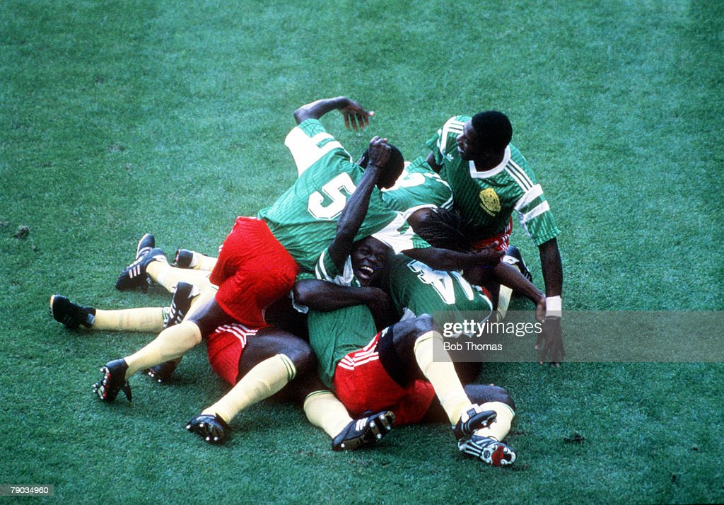 1990 World Cup Finals. Milan, Italy. 8th June, 1990. Argentina 0 v Cameroon 1. Cameroon players pile on top of each other as they celebrate the only goal scored by Omam Biyick. : News Photo