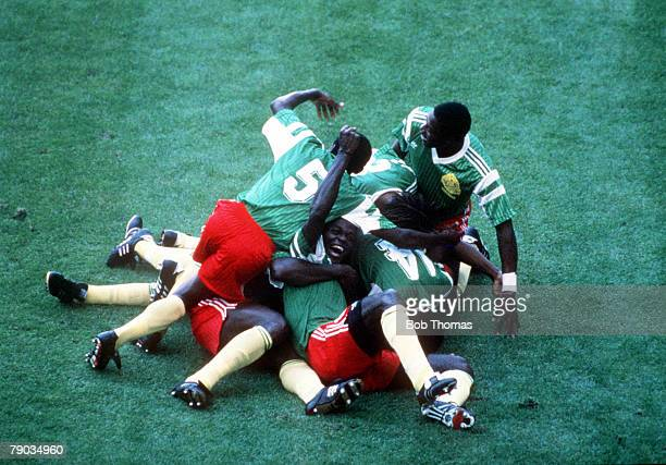 World Cup Finals Milan Italy 8th June Argentina 0 v Cameroon 1 Cameroon players pile on top of each other as they celebrate the only goal scored by...