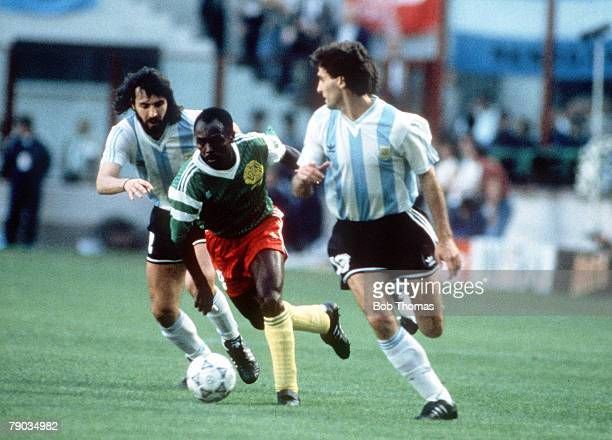 World Cup Finals Milan Italy 8th June Argentina 0 v Cameroon 1 Cameroon's Roger Feutmba takes on Argentina's Oscar Ruggeri and Sergio Batista