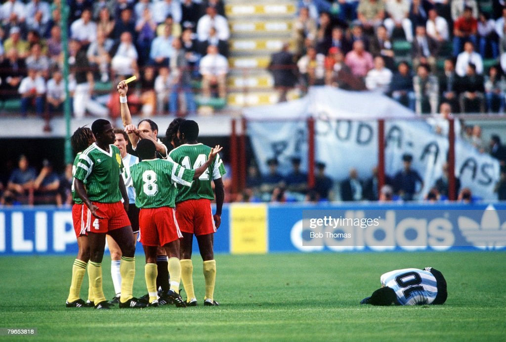 1990 World Cup Finals, Milan, Italy, 8th June, 1990, Opening Ceremony, Cameroon's Benjamin Massing is booked by the referee for a foul on Argentina's Diego Maradona : News Photo