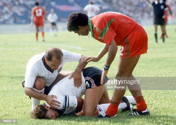 World Cup Finals Monterrey Mexico 6th June 1986 England 0 v Morocco 0 England's Bryan Robson clutches his injured shoulder as Ray Wilkins and...