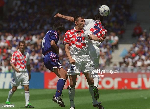 World Cup Finals Nantes France 20th JUNE 1998 Japan 0 v Croatia 1 Japan's Motohiro Yamaguchi is stopped by Croatia's Aloisa Asanovic and Krunoslav...