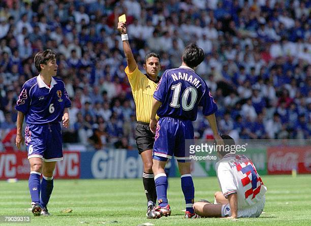 World Cup Finals Nantes France 20th JUNE 1998 Japan 0 v Croatia 1 Japan's Hiroshi Nanami receives a yellow card after fouling Croatia's Aloisa...