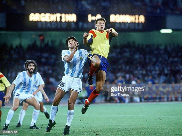 World Cup Finals Naples Italy 18th June Argentina 1 v Romania 1 Argentina's Pedro Monzon battles for the ball in the air with Romania's Gheorghe...