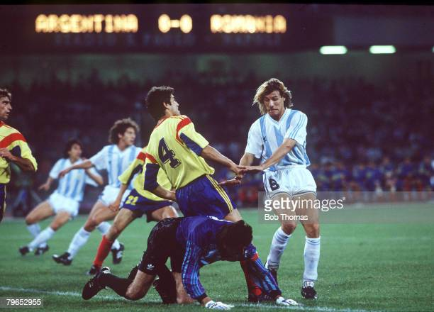 World Cup Finals Naples Italy 18th June Argentina 1 v Romania 1 Argentina's Claudio Caniggia battles with Romania's Ion Andone and goalkeeper Silviu...