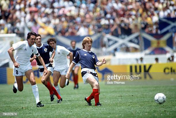 World Cup Finals Neza Mexico 13th June Scotland 0 v Uruguay 0 Scotland's Gordon Strachan plays the ball as Uruguay's Jorge Barrios moves in to...