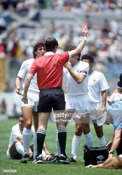 World Cup Finals Neza Mexico 13th June Scotland 0 v Uruguay 0 Uruguay's Jose Batista is shown the red card by the referee after a foul on Gordon...