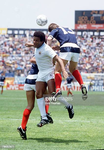 World Cup Finals Neza Mexico 13th June Scotland 0 v Uruguay 0 Scotland's Steve Nicol jumps up for the ball with Uruguay's Victor Diogo