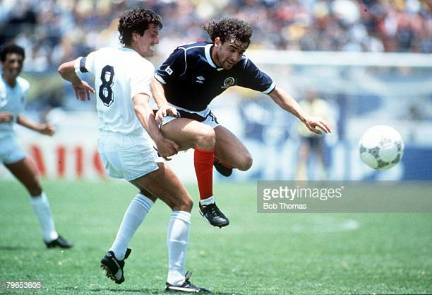 World Cup Finals Neza Mexico 13th June Uruguay 0 v Scotland 0 Scotland's Arthur Albiston leaps past Uruguay's Jorge Barrios with the ball