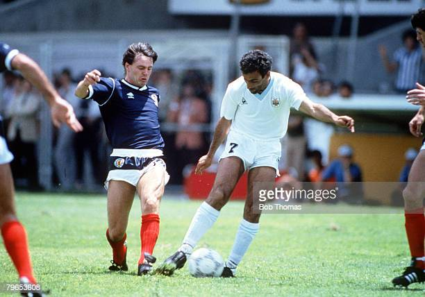 World Cup Finals Neza Mexico 13th June Uruguay 0 v Scotland 0 Uruguay's Antonio Alzamendi is challenged for the ball by Scotland's Charlie Nicholas